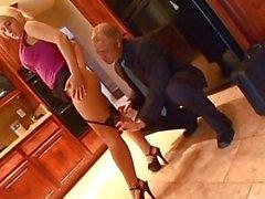 Gorgeous blonde pornstar in heels gets fucked in kitchen
