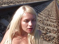 hot blonde pleasuring herself on deserted railtrack