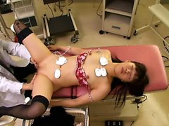 Beautiful Asian coquette gets fucked while lying on the hos