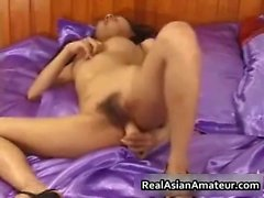 Petite asian babe strips and dildo