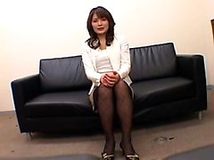 Pantyhosed Oriental lady with a magnificent ass sits on a g