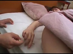 Japanese babe enjoys a hot oily massage with fingering