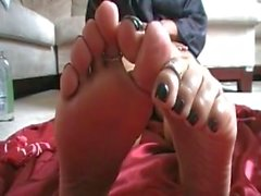 She teases you with black polish on her MILF feet