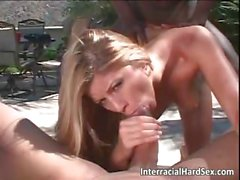 Interracial threesome sex by the pool