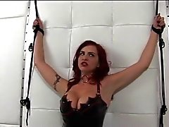 Hot redhead in leather and perky tits gets ducked by dildo