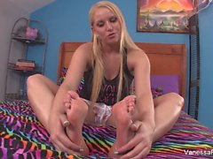 Blonde cutie Vanessa Cage plays with her feet