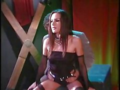 Brunette in black garters swallows hard cock