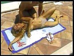Busty bikini girl and pool studd being watched