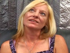 A slender blonde milf with pierced nipples