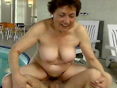 Fiery redhead milf Abby relinquishes her hairy pussy to a younger guy