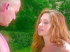 A redhead and a brunette share a hard cock, hot cumshot outside