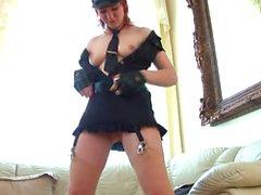 Sexy policewoman masturbates solo with a glass dildo