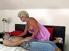 Nasty granny enjoys sex with a boy