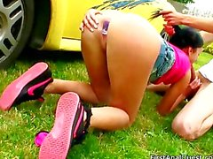 Teenage girl gets anal sex near her yellow car.