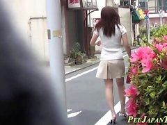 Asian in heels urinates