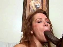 Thick busty white slut takes on a big black cock