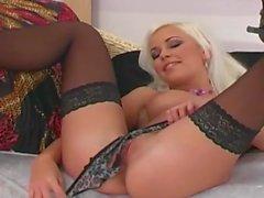 Sexy blonde masturbates in lingerie and heels