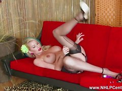 Busty blonde babe opens her long nylon legs and masturbates