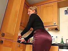 Blonde babe in kitchen pose hard
