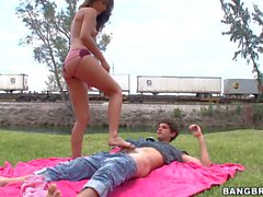 Skinny latina teen in thong AJ Estrada gives footjob outdoors