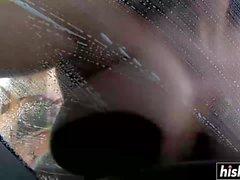 Beautiful girls wash an expensive car