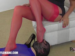 Gimp slave kisses and worships Milf Nylon Janes sexy stocking covered feet and legs