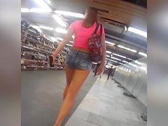 girl in short jeans teasing in public