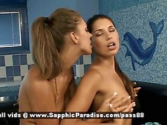 Cherie and Zafira stunning brunette and redhead lesbian girls touching on the couch