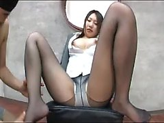 Pantyhosed Oriental beauty works her sexy feet on every inc
