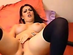 Busty amateur brunette toying herself on web cam