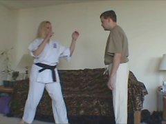 Female Black Belt demos how to break his balls