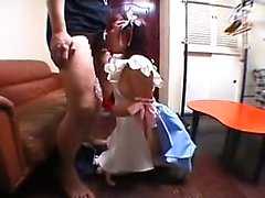 Pretty Japanese teen in a sexy outfit displays her blowjob