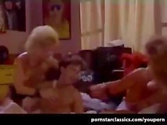Vintage hardcore threesome action with classic pornstar Nina Hartley