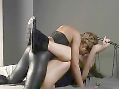 Two girls in latex banging with strap on