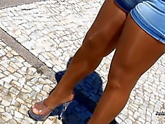 Pantyhosed legs in a sunny day