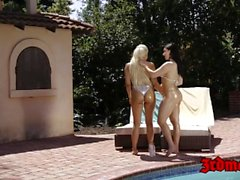 Horny bikini lesbians fingering and licking pussy outdoors