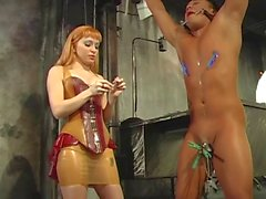 Sexy redhaired Mistress engages in a clothespins CBT session with oriental slave