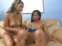 Two ebony babes go down for some pussy and use a vibrator
