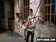 Hanging uncircumcised stud gets his cock tugged on