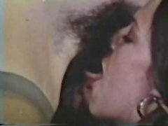 Classic vintage lesbian action with hairy pussies and a strapon