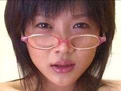 Young Japanese in glasses marked with jism