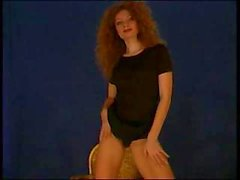 Curly redhead strips and puts on a show on her home webcam