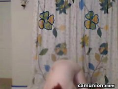 Cute Cam Girl Rubs Oil On Her Body