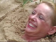 buried in sand feet tickled