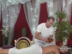 Brunette beauty fucked on massage table