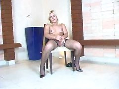 Blonde in lingerie jerks off on the chair