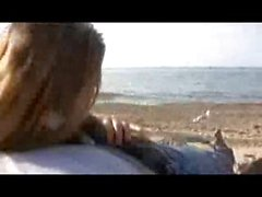 White milf sucks & fucks her black boytoy on the beach
