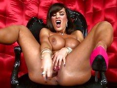 Scorching Lisa Ann rams her dildo deep in her wet slot