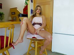 Southern belle brunette plays with dildo in the kitchen