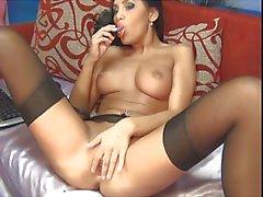 Lorrena masturbating in her sexy black garter belt